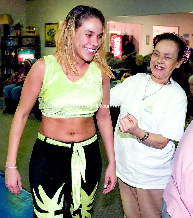 WATERBURY, CT. 22 January 2007--012207SV11--WWE diva Mercedes Martinez of Waterbury jokes around with Maria Soto of Waterbury during a show at Daybreak, an adult day care, in Waterbury Monday. Steven Valenti Republican-American