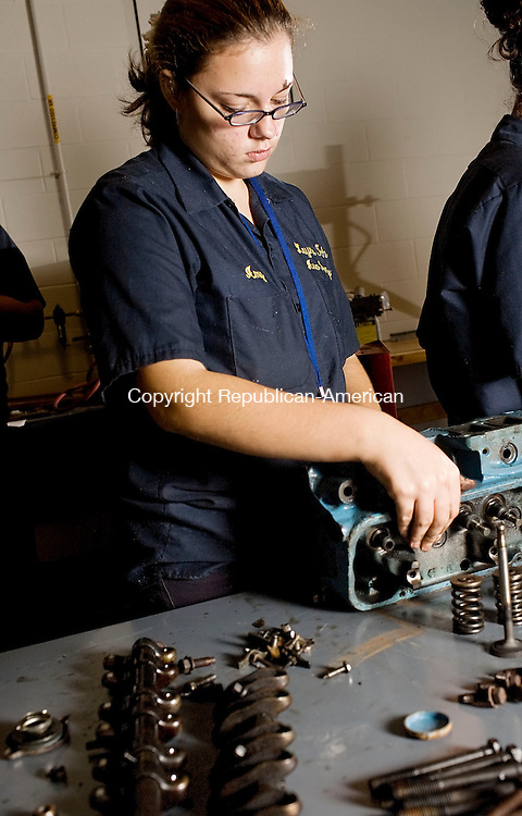 WATERBURY, CT--24 October 07--102407TJ04 - Sheana Dannic, 14, from Waterbury, works on a rebuild of a 1973 Buick 350 engine in the automotive technology shop at the W.F. Kaynor Technical High School on Wednesday, October 25, 2007. T.J. Kirkpatrick/Republican-American