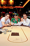 Poker professionals Luke Schwartz, Vanessa Rousso and Yevgeniy Timoshenko pose together for a portrait session.