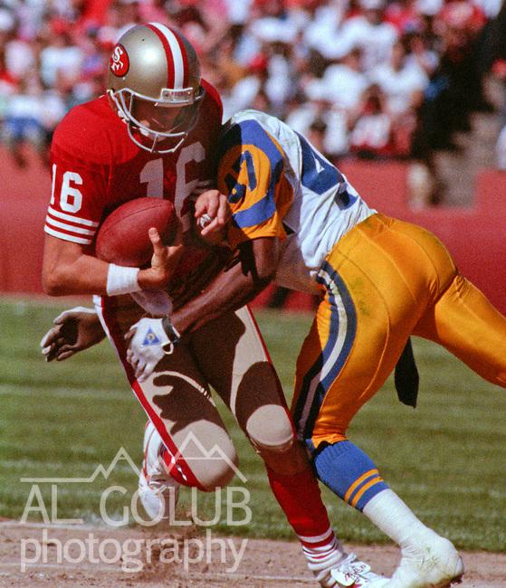 San Francisco 49ers vs Los Angles Rams at Candlestick Park Sunday, October 1, 1989..Rams Beat 49ers 13-12.Rams defensive back LeRoy Irvin (47) sacks San Francisco quarterback Joe Montana (160..