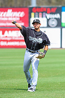 Lansing Lugnuts third baseman Yeltsin Guidino (31) warms up in the outfield prior to a Midwest League game against the Wisconsin Timber Rattlers on May 8, 2018 at Fox Cities Stadium in Appleton, Wisconsin. Lansing defeated Wisconsin 11-4. (Brad Krause/Four Seam Images)