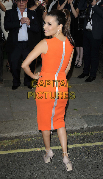 Eva Longoria.The Glamour Women Of The Year Awards 2012, Berkeley Square Gardens, Berkeley Square, London, England..May 29th, 2012.full length red orange sleeveless dress beige zip zipper looking over shoulder hand on hip back behind rear silver .CAP/CAN.©Can Nguyen/Capital Pictures.