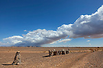 Stony desert landscape with cloudy blue sky in the Sahara desert of Morocco.