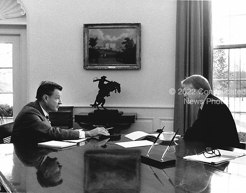National Security Advisor Dr. Zbigniew Brzezinski, left, meets with United States President Jimmy Carter in the Oval Office of the White House in Washington, DC on the President's first full day of work, January 21, 1977.<br /> Credit: White House via CNP