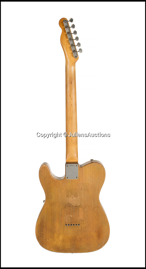 BNPS.co.uk (01202)558833Pic: JuliensAuctions/BNPS<br /> <br /> Bob Dylan's legendary electric guitar which sparked outrage from some fans who accused him of betraying his folk roots has emerged for sale for £425,000.<br /> <br /> The music icon used this 1965 Fender Telecaster electric guitar during his 1966 UK tour and encountered hostility from hecklers who shouted 'Judas' at him during performances.<br /> <br /> The guitar, which has also been used by Beatle George Harrison and Eric Clapton, belonged to Canadian musician Robbie Robertson whose band The Hawks performed with Dylan during the tour.<br /> <br /> Dylan later used this guitar on his 1966 album Blonde on Blonde and a series of 1967 recordings which would be released eight years later as The Basement Tapes.