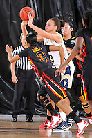 25 November 2011:  FIU guard-forward Finda Mansare (23) passes the ball after pulling down a rebound in the first half as the University of Maryland Terrapins defeated the FIU Golden Panthers, 84-52, at the U.S. Century Bank Arena in Miami, Florida.