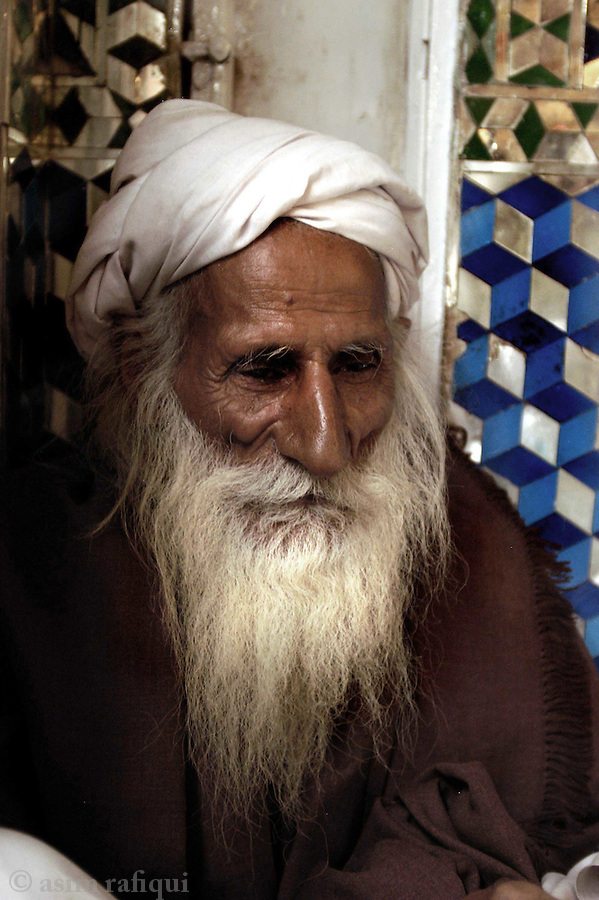 bari imam shrine, islamabad, pakistan 2004: a pilgrim sits and contemplates at the bari imam shrine<br />
