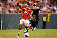 Rafael (21) of Manchester United battles Nick Zimmerman (23) of the Philadelphia Union for the ball. Manchester United (EPL) defeated the Philadelphia Union (MLS) 1-0 during an international friendly at Lincoln Financial Field in Philadelphia, PA, on July 21, 2010.