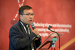 """Father John Toai from Vietnam speaks to a session of """"Faith Building Bridges"""" in Amsterdam, Netherlands. The July 21-22 interfaith event, sponsored by the World Council of Churches-Ecumenical Advocacy Alliance, was held on the eve of the 2018 International AIDS Conference."""