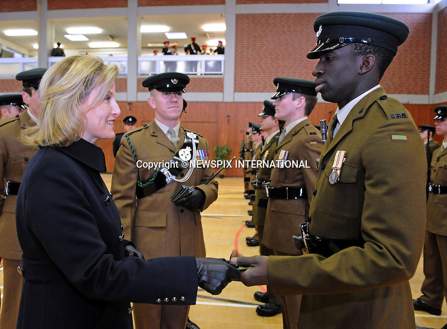 """SOPHIE, Countess of Wessex.at a special ceremony, promoted soldiers from the 5th Battalion the Rifles (5 RIFLES) based in Paderborn Germany_14/12/2010.Picture shows; Sophie Countess of Wessex making a presentation to LCpl Sainey Sanyng.Photo Credit: ©Williams_Newspix International..**ALL FEES PAYABLE TO: """"NEWSPIX INTERNATIONAL""""**..PHOTO CREDIT MANDATORY!!: NEWSPIX INTERNATIONAL..IMMEDIATE CONFIRMATION OF USAGE REQUIRED:.Newspix International, 31 Chinnery Hill, Bishop's Stortford, ENGLAND CM23 3PS.Tel:+441279 324672  ; Fax: +441279656877.Mobile:  0777568 1153.e-mail: info@newspixinternational.co.uk"""