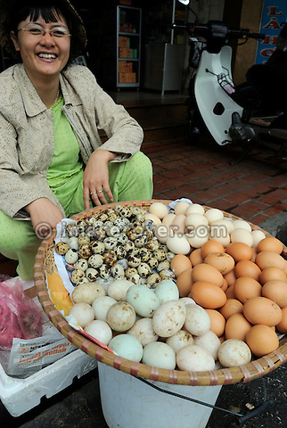 Asia, Vietnam, Hanoi. Hanoi old quarter. Vietnamese woman selling a variety of eggs on the market.