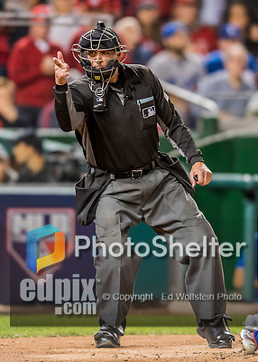 13 October 2016: MLB Umpire Jeff Kellogg calls out a strike during the NLDS Game 5 between the Los Angeles Dodgers and the Washington Nationals at Nationals Park in Washington, DC. The Dodgers edged out the Nationals 4-3, to take Game 5, and the Series, 3 games to 2, moving on to the National League Championship against the Chicago Cubs. Mandatory Credit: Ed Wolfstein Photo *** RAW (NEF) Image File Available ***