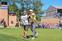 Kevin Chappell (USA) hugs caddie Joe Greiner after sinking his birdie putt on 18 to win the 2017 Valero Texas Open, AT&amp;T Oaks Course, TPC San Antonio, San Antonio, Texas, USA. 4/23/2017.<br /> Picture: Golffile | Ken Murray<br /> <br /> <br /> All photo usage must carry mandatory copyright credit (&copy; Golffile | Ken Murray)
