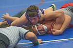 Spanish Springs Cougars Tim Fuller, top, wrestles Reno Huskies Logan Hutcherson in the 170 pound weight class on Wednesday night, January 13, 2016 at Reno High School.