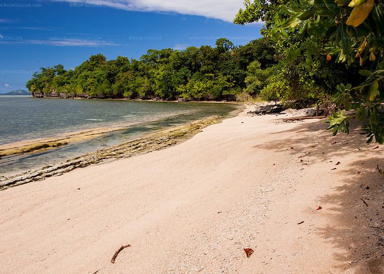 A wide sand beach surrounds the luxurious Siladen Resort and Spa on Siladen Island, in the Bunaken National Park off North Sulawesi, Indonesia.