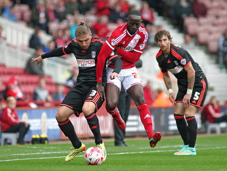 Fulham's Kostas Stafylidis battles with Middlesbrough's Albert Adomah<br /> <br /> Photographer Rich Linley/CameraSport<br /> <br /> Football - The Football League Sky Bet Championship - Middlesbrough v Fulham - Saturday 04th October 2014 - Riverside Stadium - Middlesbrough<br /> <br /> &copy; CameraSport - 43 Linden Ave. Countesthorpe. Leicester. England. LE8 5PG - Tel: +44 (0) 116 277 4147 - admin@camerasport.com - www.camerasport.com
