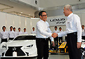 January 30, 2014, Tokyo, Japan - President Akio Toyoda, left, of Japan's Toyota Motor Corp., shakes hands with its Vice Presdident Mitsuhisa Kato during a presentation of its motor sports activities for 2014 in Tokyo on Thursday, January 30, 2014. They will include participation in the FIA World Endurance Championship and the Le Mans 24-hour race, the NASCAR racing series and the Super GT and Super Formula championships. Toyoda said its motor sports activities through Lexus Racing and Toyota Racing are aimed to bring more joy to more people through automobiles.  (Photo by Natsuki Sakai/AFLO)