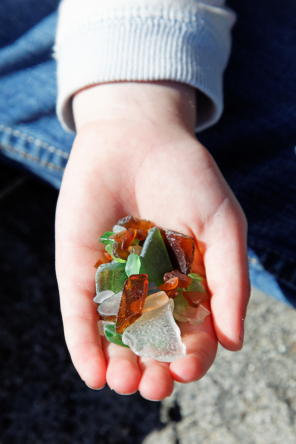 Child's hand holding beach glass,  Deception Pass State Park, Washington, USA