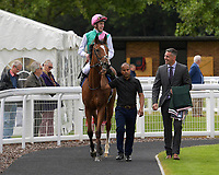 Winner of The Bob McCreery Memorial EBF Quidhampton Maiden Fillies' Stakes, Snow Shower ridden by James Doyle and trained by Sir Michael Stoute is led into the Winner's enclosure during Racing at Salisbury Racecourse on 5th September 2019