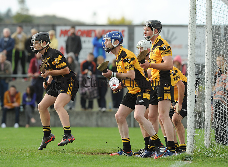 Pa Stritch of Clonlara and his defenders stand for an Inagh-Kilnamona free during their Junior A hurling final at Clarecastle. Photograph by John Kelly.
