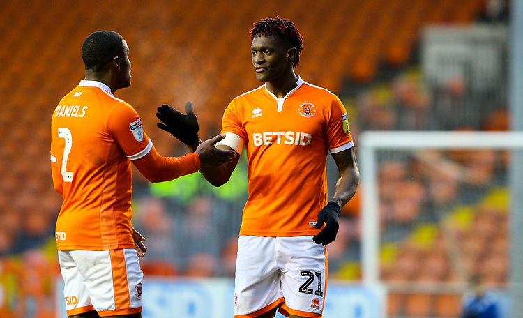 Blackpool's Armand Gnanduillet shares a moment with Donervon Daniels<br /> <br /> Photographer Alex Dodd/CameraSport<br /> <br /> The EFL Sky Bet League One - Blackpool v Shrewsbury Town - Saturday 19 January 2019 - Bloomfield Road - Blackpool<br /> <br /> World Copyright &copy; 2019 CameraSport. All rights reserved. 43 Linden Ave. Countesthorpe. Leicester. England. LE8 5PG - Tel: +44 (0) 116 277 4147 - admin@camerasport.com - www.camerasport.com