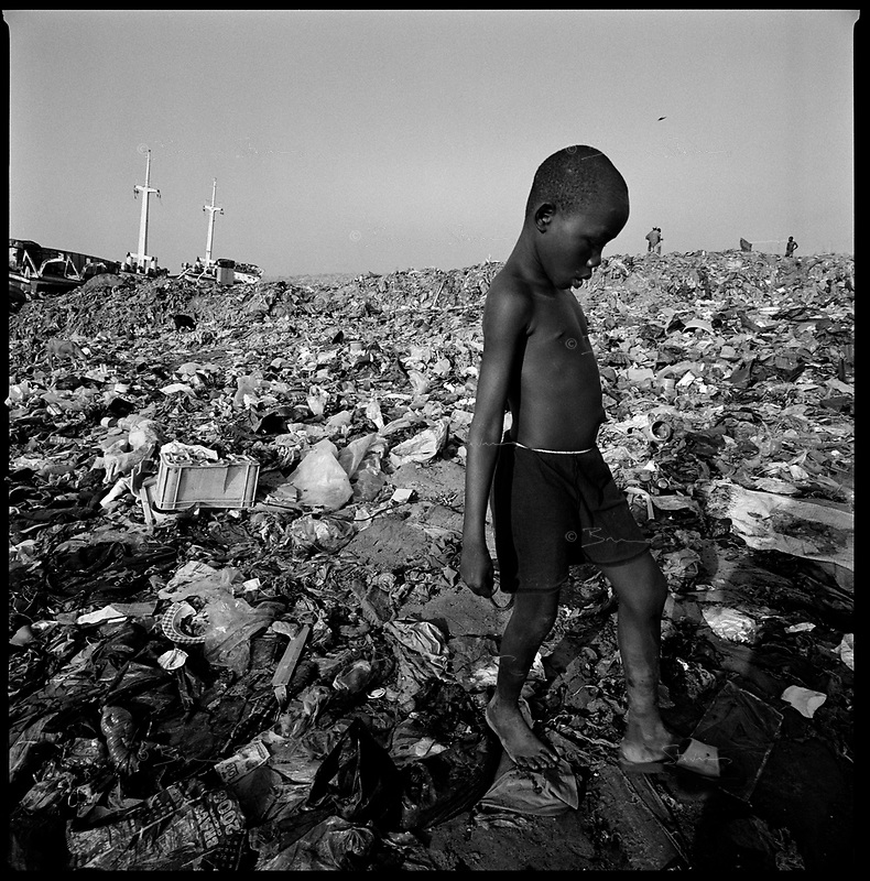 Luanda, Angola, May, 20, 2006.Porto do Pesqueiros, open air sewer; children trying to find 'valuable' objects in garbage and cholera infected waters. Between February and June 2006, more than 30000 people were infected with cholera in Angola's worse outbreak ever; more than 1300 died.