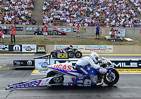 Jul, 22, 2012; Morrison, CO, USA: NHRA pro stock motorcycle rider Hector Arana Jr (near lane) races alongside Eddie Krawiec during the Mile High Nationals at Bandimere Speedway. Mandatory Credit: Mark J. Rebilas-US PRESSWIRE