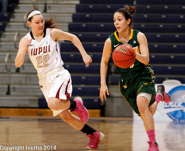 SIOUX FALLS, SD - MARCH 8:  Brooke Lemar #4 from NDSU pushes the ball past Katie Comello #22 from IUPUI in the second half of their quarterfinal game Saturday afternoon at the 2014 Summit League Championship in Sioux Falls, SD. (Photo by Dave Eggen/Inertia)