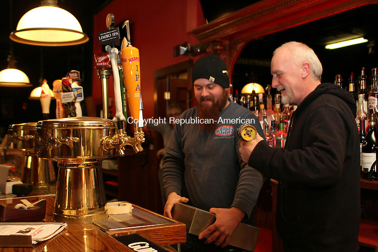 WATERTOWN, CT-23 December 2013-122313LW01 - Dwight Smith, right, the new owner of the Red Door music venue in Watertown, and his son, Dean Smith, install a dispenser that will fill beer glasses from the bottom up. The Red Door reopened Thursday after nearly three months of renovations.<br />