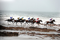 31-8-2014: Danny Sheehy on  'One of the Boys' (green yellow stripes) takes his tme before going on to victory on the beach at the Glenbeigh Races on Rossbeigh Strand in County Kerry on Sunday.<br /> Picture by Don MacMonagle