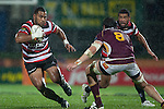 Samisoni Fisilau looks to avoid Elliot Dixon as he makes a run upfield. ITM Cup Round 4 and Ranfurly Shield rugby game between Counties Manukau Steelers and Southland, played at Rugby Park Invercargill, on Friday July 29th 2011..Southland won the game 22 - 14 after leading 13 - 6 at halftime.