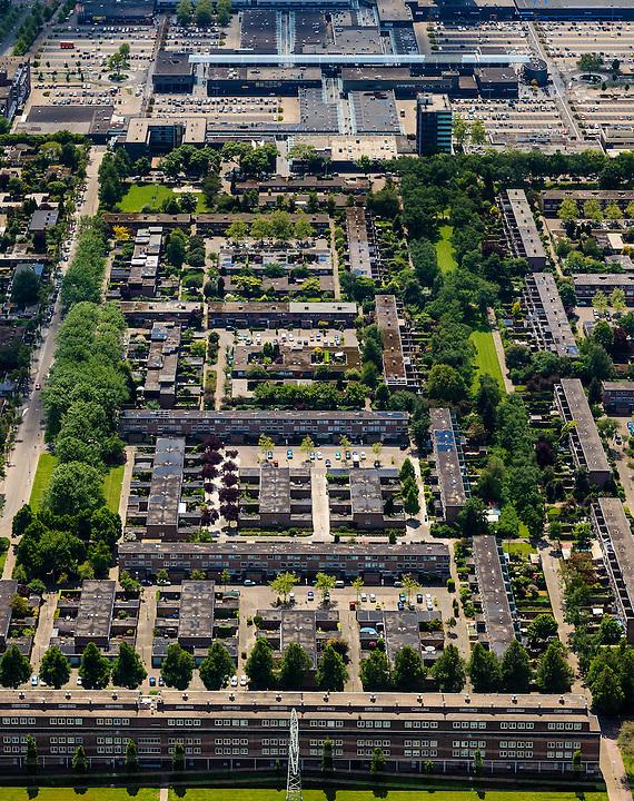 Nederland, Noord-Brabant, Eindhoven, 27-05-2013; stadsdeel Woensel-Noord, wijk Ontginning, buurt &rsquo;t Hool. Boven in beeld winkelentrum Woensel.<br /> De woonbuurt met verschillende woningtypes is tussen 1968 en 1972 gerealiseerd en geldt als toonbeeld van de wederopbouw architectuur en stedenbouw. Architect Jaap Bakema.<br /> Residential area in Eindhoven with various housing types realized between 1968 and 1972. The design is considered a model of architecture and urban reconstruction. Architect Jaap Bakema.<br /> luchtfoto (toeslag op standard tarieven)<br /> aerial photo (additional fee required)<br /> copyright foto/photo Siebe Swart
