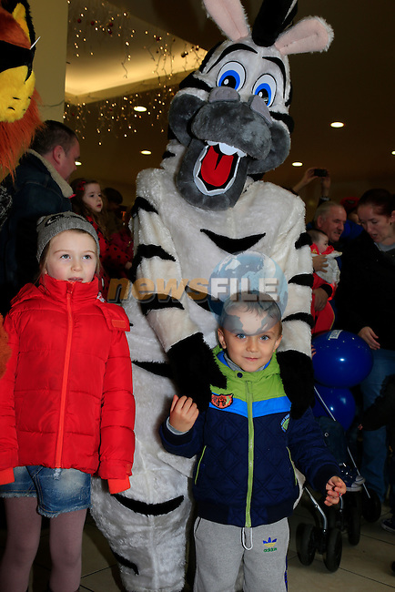 Carlos and the zebra waiting for Santa arriving at the Drogheda Town centre.<br /> Picture: Fran Caffrey www.newsfile.ie