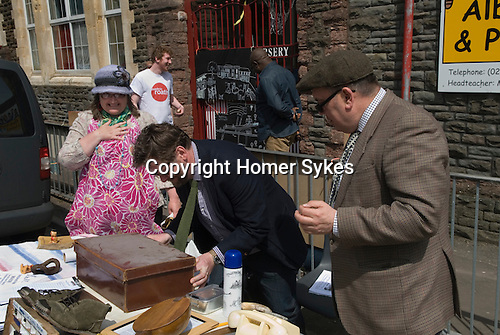 Made In Spring. Roath Cardiff Wales. The Actual History of Museum's curator Sir Glen Roy with the assistance of fellow curator Lord Alfred Street and Dame Shirley Road, opens a trunk of Roath artefacts which hasn't been opened since 2008. May 2014