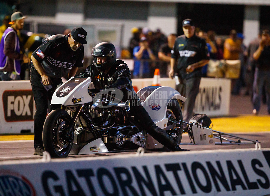 Mar 16, 2018; Gainesville, FL, USA; Crew member with NHRA nitro top fuel Harley Davidson motorcycle rider Beau Layne during qualifying for the Gatornationals at Gainesville Raceway. Mandatory Credit: Mark J. Rebilas-USA TODAY Sports