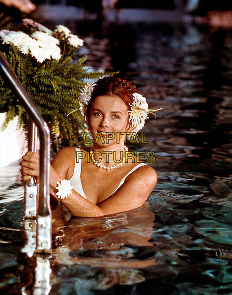 ANN-MARGARET, in swimming pool, wearing pearls and flowers in her hair, undated.*Filmstill - Editorial Use Only*.CAP/PLF.Supplied by Capital Pictures.