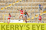 Padraig Mac A'Tsítigh Daingean Uí Chúis, Sean Kelliher and David Roche Mid Kerry contest the kick out during the County Minor championship final in Fitzgerald Stadium on Sunday