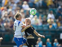 Boston's Kacey Moore, left, and Carrie Drew, right, battle for a head ball. FC Gold Pride defeated the Boston Breakers 2-1 at Buck Shaw Stadium in Santa Clara, California on April 5th, 2009.