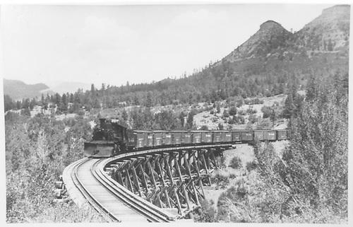 RGS eastbound freight train crossing Bridge 160-A (Lightner Creek Trestle).<br /> RGS  Franklin Junction, CO