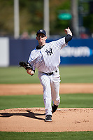 New York Yankees starting pitcher James Paxton (65) delivers a pitch during a Grapefruit League Spring Training game against the Toronto Blue Jays on February 25, 2019 at George M. Steinbrenner Field in Tampa, Florida.  Yankees defeated the Blue Jays 3-0.  (Mike Janes/Four Seam Images)