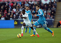 SWANSEA, WALES - FEBRUARY 07: L-R Nathan Dyer of Swansea chased by Ricky Alvarez of Sunderland during the Premier League match between Swansea City and Sunderland AFC at Liberty Stadium on February 7, 2015 in Swansea, Wales.