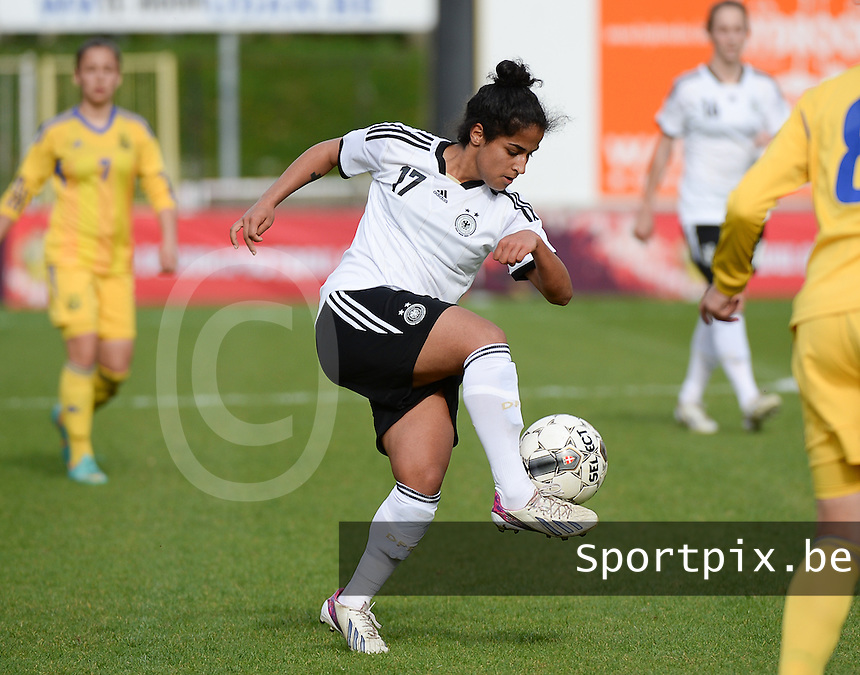 20140407 - BRUSSELS , BELGIUM : German Venus El-Kassem pictured during the female soccer match between GERMANY U19 and UKRAINE U19 , in the second game of the Elite round in group 4 in the UEFA European Women's Under 19 competition 2014 in the Edmond Machtens Stadion , Monday 7 April 2014 in Brussels . PHOTO DAVID CATRY