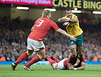 Australia's Kurtley Beale is tackled by Wales' Taulupe Faletau<br /> <br /> Photographer Simon King/CameraSport<br /> <br /> International Rugby Union - 2017 Under Armour Series Autumn Internationals - Wales v Australia - Saturday 11th November 2017 - Principality Stadium - Cardiff<br /> <br /> World Copyright &copy; 2017 CameraSport. All rights reserved. 43 Linden Ave. Countesthorpe. Leicester. England. LE8 5PG - Tel: +44 (0) 116 277 4147 - admin@camerasport.com - www.camerasport.com
