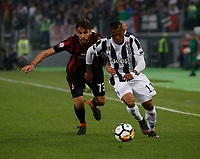 Douglas Costa of Juventus  and Manuel Locatelli  during the  Coppa Italia ( Tim Cup) final soccer match,  Ac Milan  - Juventus Fc       at  the Stadio Olimpico in Rome  Italy , 09 May 2018