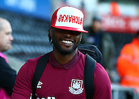 Alex Song of West Ham United arrives with a bizarre hat before the Barclays Premier League match between Swansea City and West Ham United played at The Liberty Stadium, Swansea on 20th December 2015