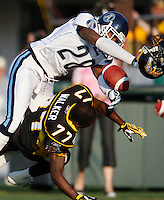 Jul 7, 2007; Hamilton, ON, CAN; Toronto Argonauts defensive back (28) Byron Parker levels Hamilton Tiger-Cats wide receiver (77) Jo Jo Walker, forcing an incomplete pass, during the first quarter of the 2007 season home opener at Ivor Wynne Stadium. The Argos defeated the Tiger-Cats 30-5. Mandatory Credit: Ron Scheffler, Special to the Spectator.