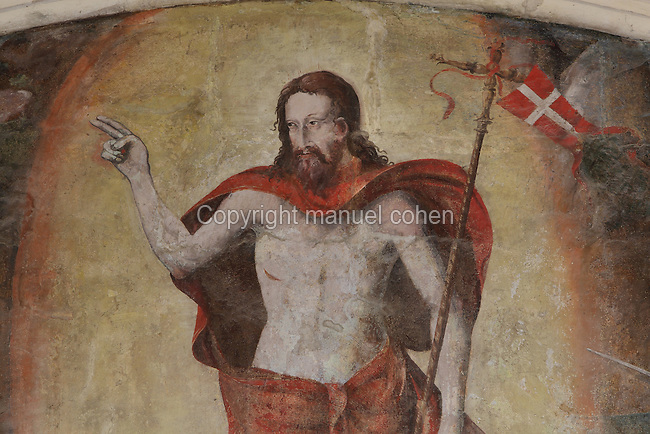 Christ's resurrection into Heaven. He is clothed in red and holds the red standard with white cross which has been the flag of the French army since the 14th century, Resurrection fresco, Chapter House, Fontevraud Abbey, Fontevraud-l'Abbaye, Loire Valley, Maine-et-Loire, France. The Chapter House was built in the 16th century and its walls were painted in 1563 with frescoes of scenes from Christ's Passion by the Anjou artist Thomas Pot. The abbey itself was founded in 1100 by Robert of Arbrissel, who created the Order of Fontevraud. It was a double monastery for monks and nuns, run by an abbess. Picture by Manuel Cohen