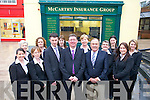 Donal Buckley, James McAuley and Joseph M Murphy pictured outside their Tralee premises with the staff.   Copyright Kerry's Eye 2008