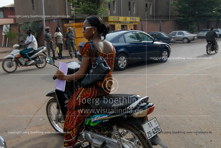 Burkina Faso, Ouagadougou, woman with scooter / Frau mit Motorroller