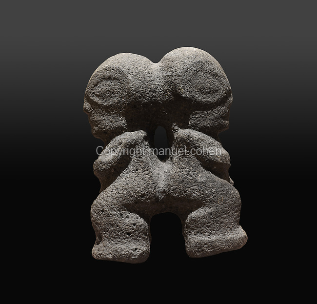 Small janiform double tiki statuette in basalt, 15.8cm tall, with 2 bodies facing away from each other and joined at the back and head, in the Musee de Tahiti et des Iles, or Te Fare Manaha, at Punaauia, on the island of Tahiti, in the Windward Islands, Society Islands, French Polynesia. Tikis are protective statues representing Ti'i, a half-human half-god ancestor who is believed to be the first man. The Museum of Tahiti and the Islands was opened in 1974 and displays collections of nature and anthropology, habitations and artefacts, social and religious life and the history of French Polynesia. Picture by Manuel Cohen